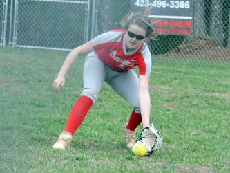 Lady Cougar Haley Harper scoops up a ground ball during the Lady Cougars first game of the season Monday, March 9.