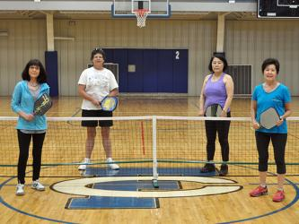 Pickleball players from left, Lynden Willits, Lori Schaltz, Kim Curry and Gail O'Neal take a break from playing pickleball for a photo at the Fannin County Recreation Center Thursday, May 7.