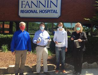 Fannin County High School freshman Bryce Ware created reusable mask, respirators and face shields for employees at Fannin Regional Hospital. Shown are, from left, Engineering teacher Bubba Gibbs, Fannin Regional Chief Executive Officer Jason Jones, Ware and Fannin Regional Executive Director of Nursing Stephanie Monico.