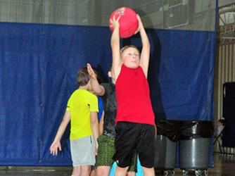 Lucas Cox catches the ball to avoid being put out during the Fannin County Recreation Department's Summer Camp Wednesday, June 3.