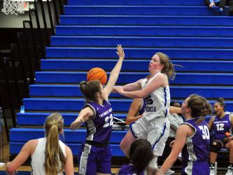 Lady Rebel Morgan Holt goes up for a contested layup this past season for the Fannin County Lady Rebels basketball team.