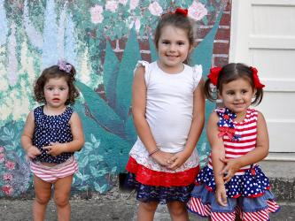These Morgan family cuties were all dolled up for McCaysville's annual fireworks show Friday, July 3. They are, from left, Allie, Presley and Riley.