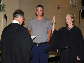 Polk County General Sessions Judge Brooklyn Townsend takes her oath of office from Circuit Court Judge Mike Sharp as her husband, Chris, looks on. Townsend was elected to serve the last two years of the unexpired term of Bill Baliles.