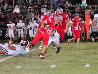 Copper Basin Cougar Sebastian Baliles (12) muscles his way through a defender in recent action for the Copper Basin Cougars football team.