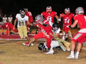 Sebastian Balilies (12) sheds a tackle during the Cougars game against the Clay County Bulldogs Friday, November 6.
