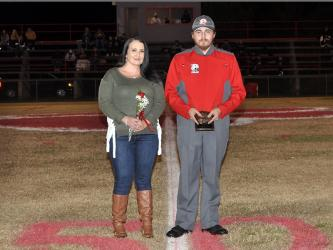 Copper Basin High School honored their golf, band, cheerleaders and football seniors Friday, November 6, at the Cougars home playoff game against Clay County. Senior band member Zeke Brendle is shown with Dena Crawford Brendle.
