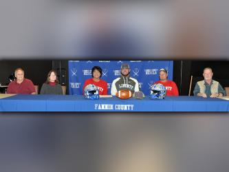 Fannin County football senior Mason Bundy signed to play football with the Liberty University Flames Wednesday, December 16. Shown following the signing are, from left, Jerry Garren, uncle; Cindy Garren, aunt; Dena Johnson, mother; Bundy; Chris Johnson, father; and Scott Johnson, uncle.