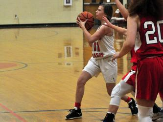 Lady Cougar Summer Montgomery passes to the open player during the Lady Cougars game against Polk County Thursday, December 3.