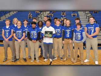 The Fannin County Rebel football team was recognized for the Georgia High School Football Daily's (GHSFD) State Team of the Week Award Wednesday, December 9. Seniors gathered with Rebel Head Coach Chad Cheatham to celebrate the recognition. Shown, from left, front, McCay Turner, James Mercer, Christian Resendiz, coach Cheatham, Micah O'Neal, Jake Sands and Caleb Postell; back row,  Dalton Ross, Brayden Foster, Tommy Ledford, Andre Bivens, Mason Bundy, Jalen Ingram, Luke Holloway, junior Seth Reece and Chris