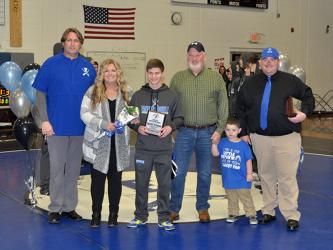 Kolton Stephens was one of seven seniors honored at Fannin County High School wrestling senior night Friday, January 15. Shown during the ceremony are, from left, Coach Alan Collis, mother, Robin Stephens, Stephens, father, John Stephens, nephew, Anderson Cheek, and Coach Chuck Patterson.