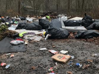 Garbage in this dump site in the Shuler Creek area of Polk County revealed the names of four Georgia residents. Those residents have been charged by U.S. Forest Service law enforcement officers and face federal penalties if convicted.