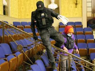 "This photo of an individual, referred to on the internet as the ""zip tie guy,"" taken inside the Senate's Chamber dressed in paramilitary gear and holding zip ties is believed to be Eric Gavelek Munchel, a 2009 graduate of Fannin County High School."