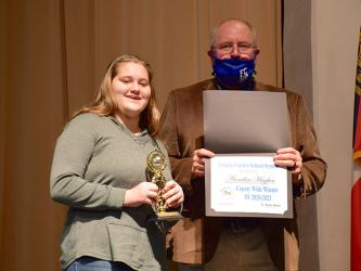 "Fannin County Middle School student Annelise Hughes ended the Fannin County School System District Spelling Bee as the winner after spelling the winning word, ""Etruscan,"" correctly Thursday, January 14. She will now move on to the region level. She is joined by Principal Keith Nuckolls."