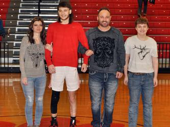 Copper Basin held its senior night ceremony for the basketball and cheer seniors Saturday, February 6. Shown during the ceremony are, from left, mother, Deanne Burkett; senior, Logan Burkett; father, Josh Burkett; and brother Joshua Burkett.