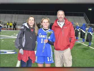 Ana Arvidson was one of 14 seniors honored during Fannin's home soccer game against Gordon Central Friday, February 19. Arvidson is shown with her parents, Nathan and Deana Arvidson.