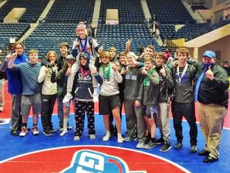 The Fannin County Rebels wrestling team won their first state championship as they topped Lovett in the state title match. The Rebels' wrestling team are shown following the big win, which was the first male athletic team to win a state championship at Fannin County High School.